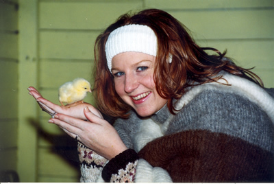 girl with baby chick